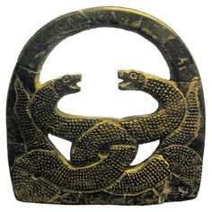 Azerbaijan Museum, Tabriz (Iran). Rock weight symmetrically-carved entwined paired serpents, Jiroft, 3rd mil. BC |