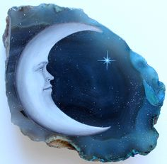 blue moon painting on a rock