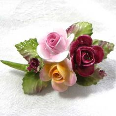 Pretty bouquet spray shaped vintage brooch of bone china rose flower 1970s flower brooch with a purple-red, yellow and pink rose hand painted flowers