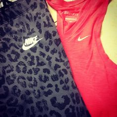 Black cheetah nike pants and pink nike tank top