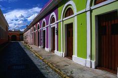 Brilliantly coloured houses on the cobblestoned street leading to Calle (street)Virtud, OSJ, PR