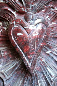 Where the Heart Is.  This is a detail on a fireplace in le salon de rose.