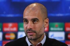 Pep Guardiola the coach of FC Bayern Muenchen faces the media during a press conference at the Lowry Hotel on November 24, 2014 in Manchester, United Kingdom.