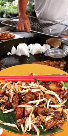 Sampling local dishes in Penang, Malaysia