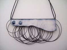 Thea Clark - enamel on copper, steel wire