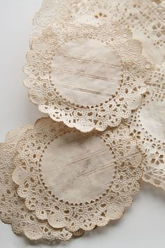 Coffee stained paper doilies.