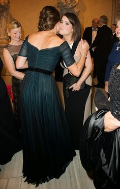Catherine, Duchess of Cambridge meets Princess Eugenie of York at the St. Andrews 600th Anniversary Dinner on 09.12.2014 in New York City.