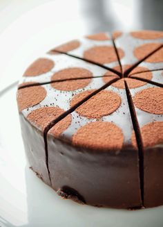 A Brandy-Infused Devil's Food Cake with Chocolate Ganache, Chocolate Mascarpone Mousse and Chococlate Glaze.  All of our restaurants are made from scratch in our restaurant in Uptown.  The Chocolate Mascarpone Torta is available whole, pefect for celebrations, or by the slice.