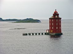 Kjeungskjaer sits on a rock off the Norwegian coast, just to the northwest of the small town of Uthaug. Accessible only by boat, Kjeungskjaer is one of the loveliest, and loneliest, lighthouses in Norway.