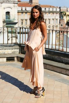 Alicia dressed in peach Stella McCartney ruffle dress for The Man from U.N.C.L.E. photocall in Rome.