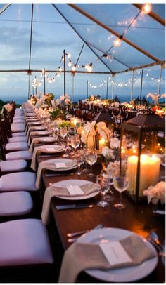 For a beautiful outdoor venue with an evening wedding reception: Rent a clear tent! Use a combination of string lighting and candlelight to create the ambiance