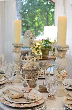 Image from http://betweennapsontheporch.net/wp-content/uploads/2013/06/Beach-Table-Setting-Nautical-Tablescape-with-Shell-Chargers-and-Shell-Napkin-Rings.jpg.