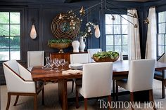 With walls stained a deep gray,  the dining room becomes a showcase after dark.- Photo: Michael Garland / Design: Heidi Bonesteel and Michele Trout