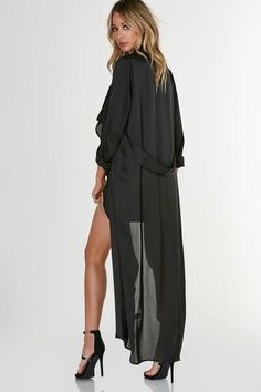 Longline, flowy duster coat with drapey open front. Long sleeves with satin like finish.  100% Polyester Made in USA Model is wearing size S Runs true to size Dry clean only