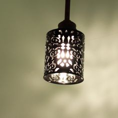 light made from candle holder here, but could recreate with upcycled pop can or tin can