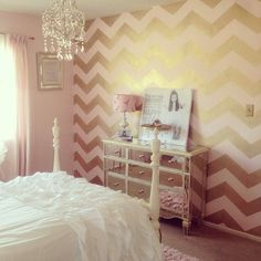 A blush pink and gold Chevron Allover stenciled accent wall in a girl's room by Maria. www.cuttingedgest...