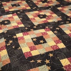 I love how simple the piecing is (just four-patches), but the color placement MAKES this quilt.