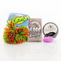 Silver tangle, thinking putty and a koosh ball make up this fiddle kit