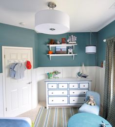 In my boy's room, we painted his walls an intense teal  called 'La Fonda Villa Fountain' by Valspar – it works well with the board and batten installation painted in Benjamin Moore's 'Dove White'.