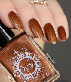 Spell Polish: Golden Handcuffs. Copper & Gold matte nail polish w/hidden shimmer. $17 a bottle, holy crap!