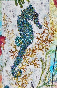 Totally bead covered seahorse in a seahorse themed machine applique pattern.