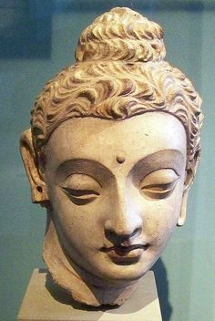 300-400 CE. Gandharan Buddhist Head  stucco. From Hadda a Greco-Buddhist archeological site near the Khyber Pass, just south of Jalalabad, Afghanistan. V&A.