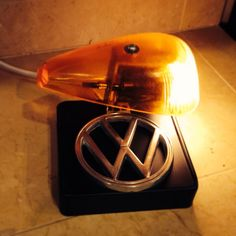 My latest creation....VW Beetle signal light from a '65ish lens with VW emblem on upcycled brass light painted flat black