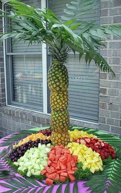 for the summer pool party fresh fruits...need to be sure to stabilize the pineapples well!