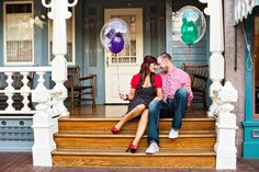 Cute shot with the Mickey Mouse balloons as props - Disneyland Park Engagement Photos: Kelly + Mark