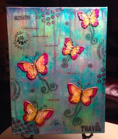 Inspired by Spring on the horizon, I created this butterfly mixed media canvas using acrylic paint, modeling paste and rub-ons.