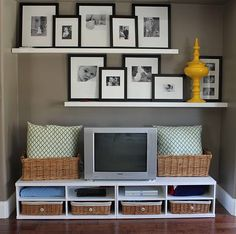 Maybe shelves like these for pictures over a shelving unit on our blank kitchen wall...  I'm thinking baskets and cookbooks on a chunky horizontal bookshelf.