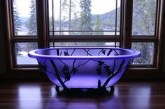 Frosted purple glass bathtub - Will be perfect as the accent to the black/gray bathroom we want!