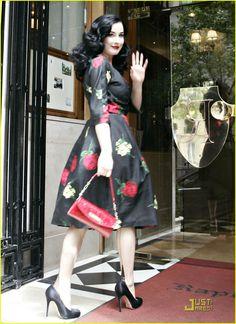 Dita in a black rose print dress
