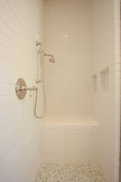 Polished nickel shower and white subway tile - would be lovely wit a big windows and natural light