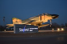 The Stafford Museum's F-4 Phantom and LED lit sign at night. Can be seen from I-40!