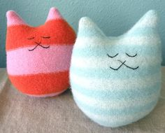 Stuffed cats made out of felted sweaters.