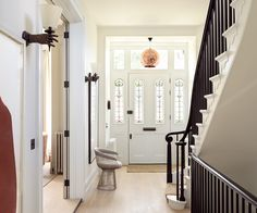 Elegant Foyer Name : Lang architecture convert a three family row house into an elegant