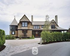 In design, as in life, the difference between good and great is the attention to detail. Shingle Style Architecture, Shingle Style Homes, Facade Design, House Design, Exterior Design, Building Contractors, Arts And Crafts House, New England Homes, Industrial House