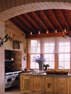 Another French Country Kitchen - also including bull's head.  Love the lavender.  The huge wooden bowl of lemons.  The bright window.