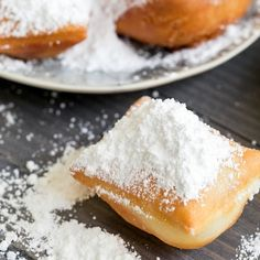Traditional New Orleans Style Beignets Recipe Breads with active dry yeast, warm water, white sugar, salt, eggs, evaporated milk, bread flour, shortening, vegetable oil, confectioners sugar