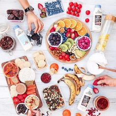 When vegans get together we feast together Pictured is an epic spread of fresh fruit, gooey Medjool dates, nuts, crackers & carrot sticks with hummus + salsa, vegan chocolate, coconut yogurt &...