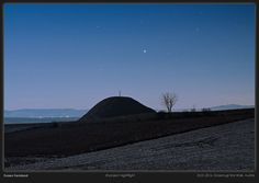 "Sirius, the Dog Star, Reigns Supreme in Dazzling Photo | The bright star Sirius presides over an ancient burial mound in a dazzling new photo by project nightflight, taken at the Grossmugl Star Walk in Austria. ""This image, shot on January 22, 2016, shows Sirius rising above the Leeberg tumulus, a 2500 years old ancient burial mound at the endpoint of the Grossmugl Star Walk,"" project nightflight wrote. 