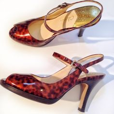 Haan Tortoise Slingback Heels Great condition. Nike Air. Only wore twice. Peep toe with sling back. Great looking 4 inch heel. Patent leather. Cole Haan Shoes Heels