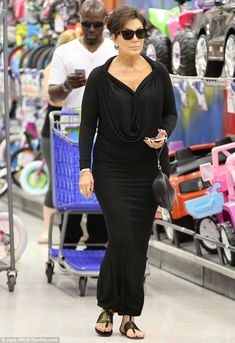 On the hunt: Kris Jenner, right, and her toyboy Corey Gamble, left, were seen shopping at Toys R Us in Los Angeles on Wednesday