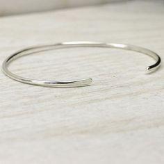 These simple and modern solid sterling silver cuff bracelets are perfect on their own or with any other piece. These cuffs come in polished 14K rose gold fill,