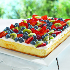 Fruity Cheesecake - Lemon pudding adds extra flavor and creaminess to this delicious cheesecake. Since this cheesecake makes enough for 24 people, this indulgent special-occasion dessert is a perfect treat to serve at your next party.