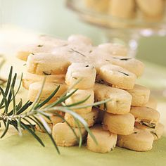"""Rosemary Shortbread  1 1/2 c all-p  1/2c butter, chilled   1/4c sifted powdered sugar  2T minced fresh rosemary  2Tgranulated sugar   Process first 4 ingredients in a food processor until mixture forms a ball.  Roll dough to 1/4"""" thickness on a lightly floured surface. Cut with a 2"""" cookie cutter; place on lightly greased baking sheets. Bake at 325F 18-20 min or until edges are lightly browned. Sprinkle w/sugar. Cool on wire racks."""
