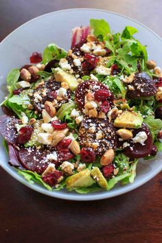 Roasted beet salad with a homemade honey balsamic vinaigrette. A flavorful and healthy salad that is anything but boring!