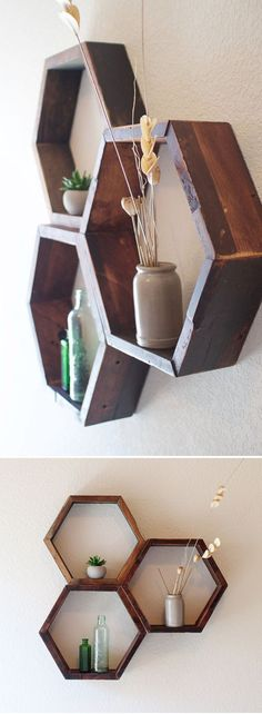 Set of 3 Wooden Hexagon Shelves.  Handmade with wood reclaimed from a vintage piano. Remnants of glue, lacquer finish, and antique stain remain on the wood imparting a charming, rustic look. These shelves work well alone or in a honeycomb grouping. DenneheyDesign.com