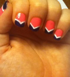 Still one of my favorites! Coral base with navy blue french tip and a white accent. #nails